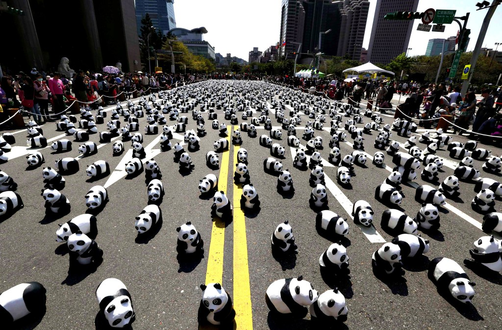 """Papier mache pandas, created by French Paolo Grangeon, are seen displayed outside the Taipei City Hall as part of an exhibition called """"Pandas on Tour"""""""