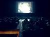 archipelago cinema, il pubblico è seduto sulla piattaforma galleggiante